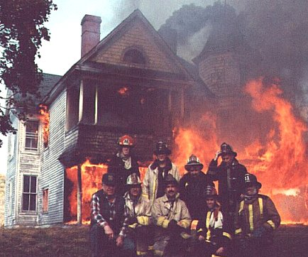 firefighters-in-front-of-house-fire.jpg